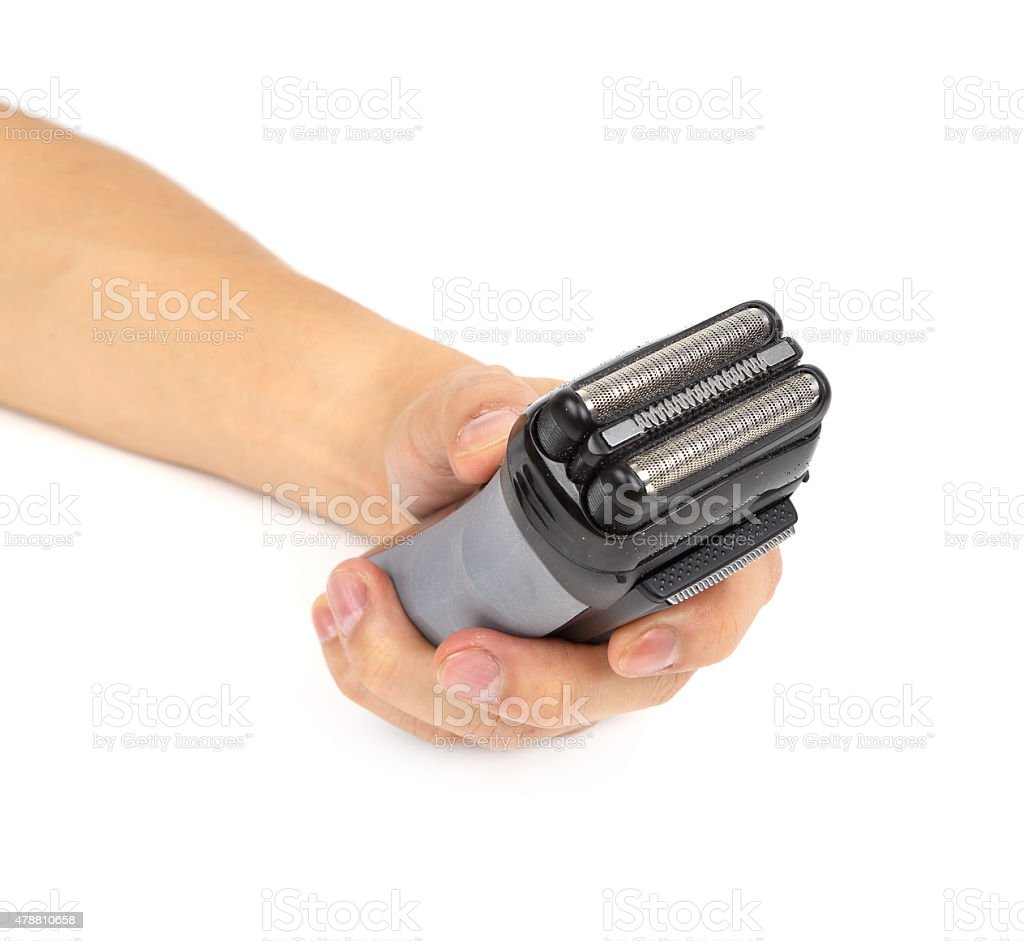 hand with electric shaver stock photo