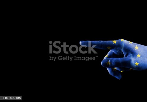 SHOWING - Hand with European union flag pointing over empty space for text / Flag concept (Click for more)