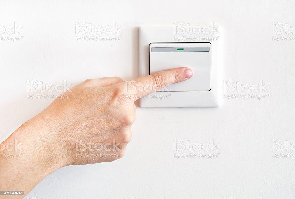 Hand Mit Finger Auf Lichtschalter - Stockfoto | iStock