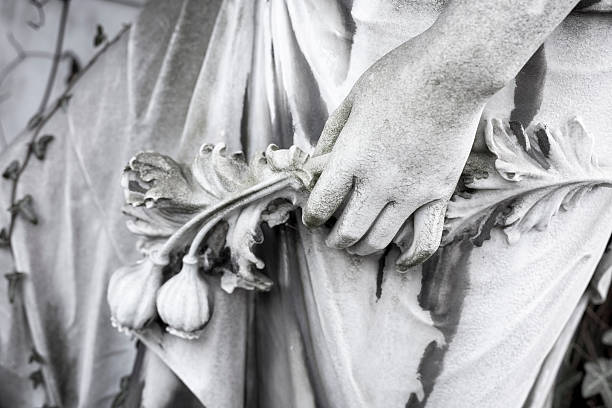 hand with flowers, close up of an old sculpture stock photo