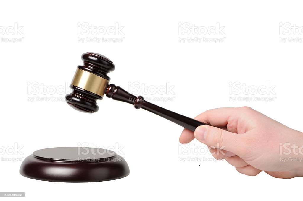 Hand with gavel on a white background stock photo