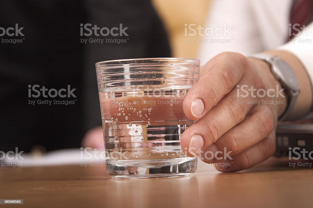 Hand with glass of water = close up - Royalty-free Breaking Stock Photo