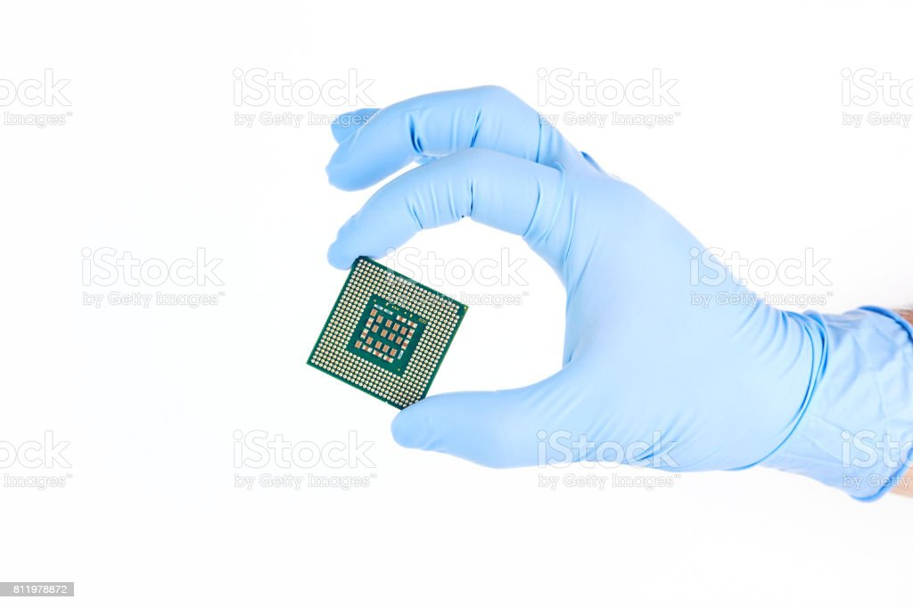 Hand With Glove Holding Small Powerful Computer Processor stock photo