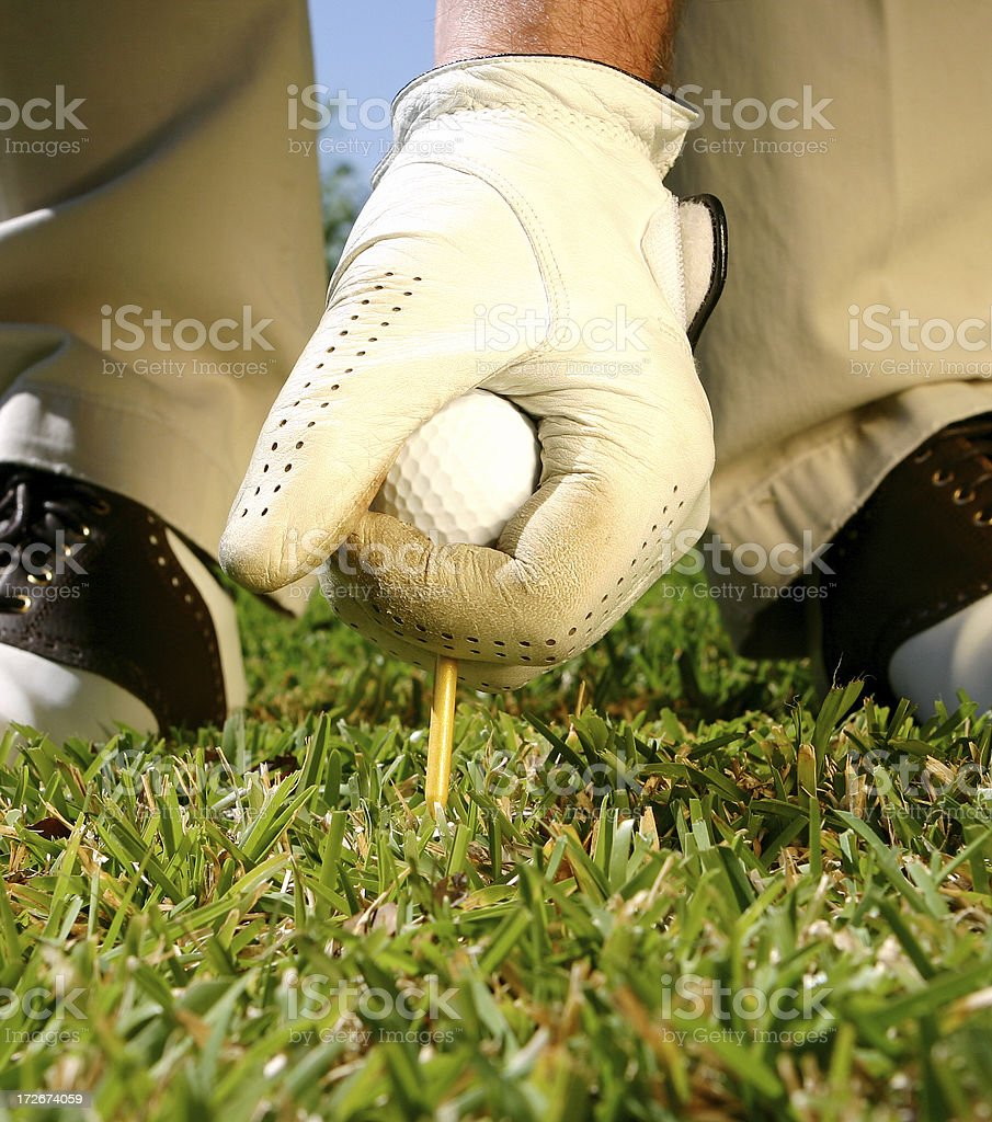 Hand with Golf Ball and Tee royalty-free stock photo