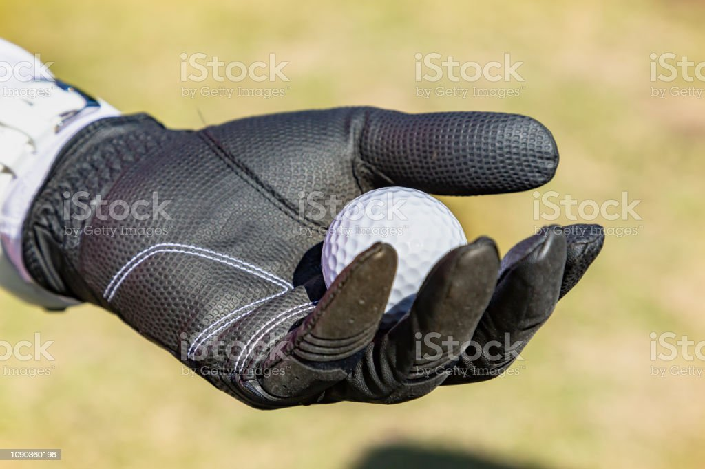 Hand with golf ball