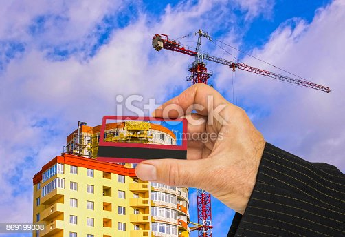 626187670istockphoto Hand with house and credit card, buy house concept 869199308