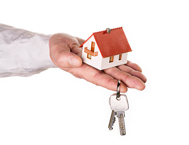 Hand with house and key stock photo