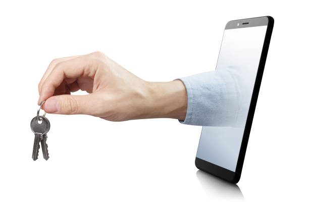 hand with keys - hand holding phone стоковые фото и изображения