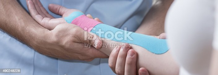 istock Hand with kinesio tape 490248228