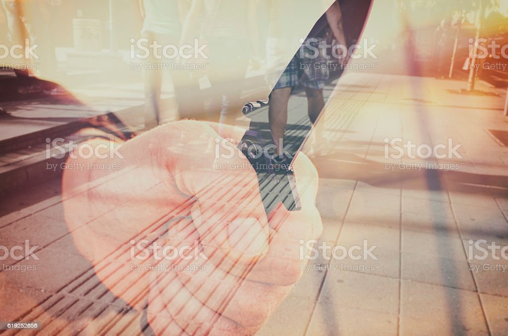 Hand with knife. Street violence concept. Double exposure. stock photo