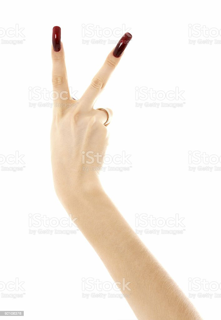 hand with long acrylic nails showing victory sign royalty-free stock photo