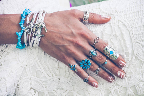 hand with lot of boho style jewerly stock photo