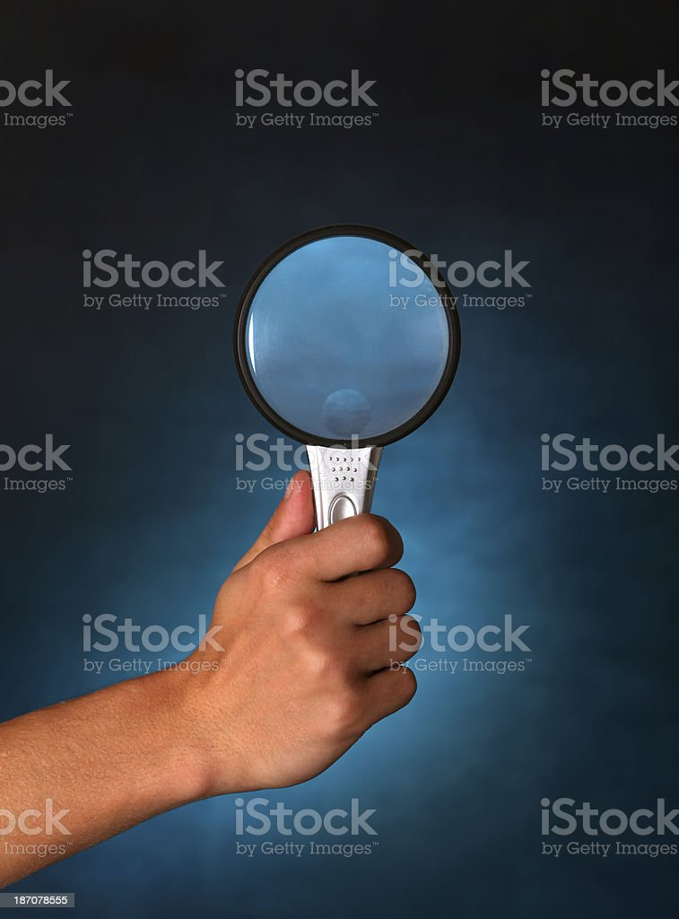 Hand with Loupe royalty-free stock photo