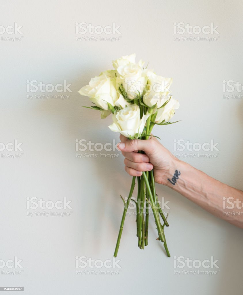 Hand With Love Tattoo Holding Cream Roses Stock Photo More