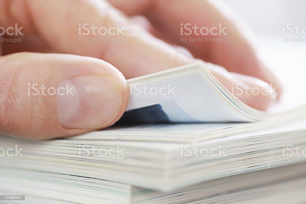 Hand with Magazines stock photo