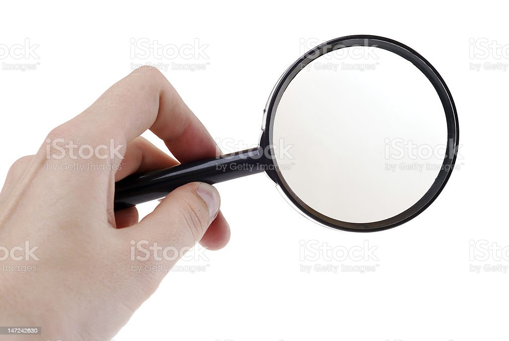 Hand with magnifying glass stock photo