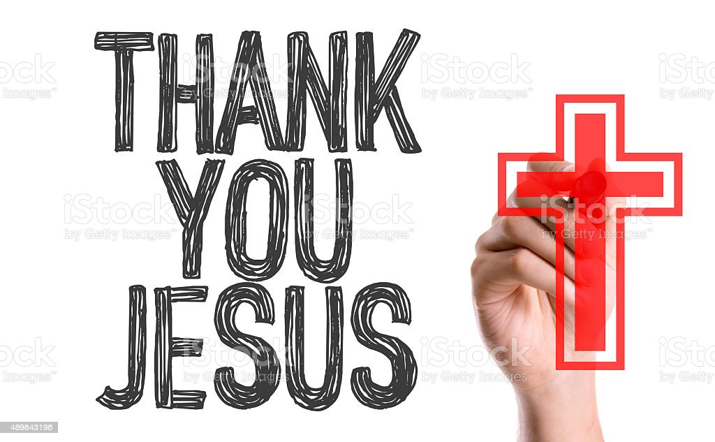 Hand with marker writing the word Thank You Jesus stock photo