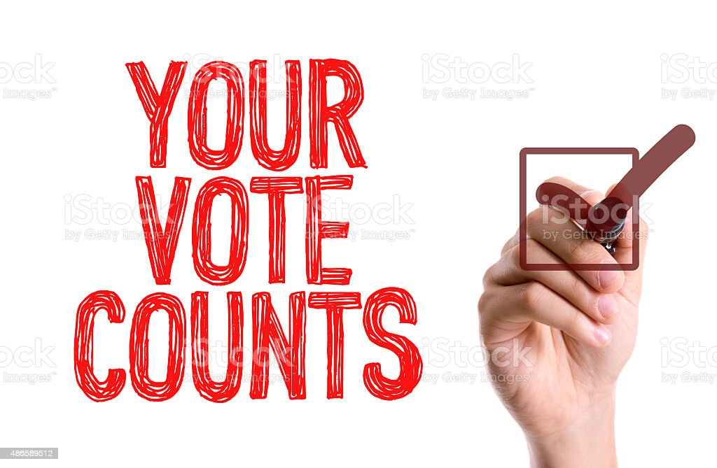 Hand with marker writing the word Your Vote Counts stock photo