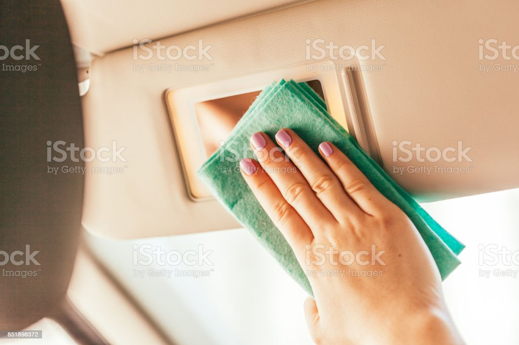 Hand with microfiber cloth cleaning car stock photo