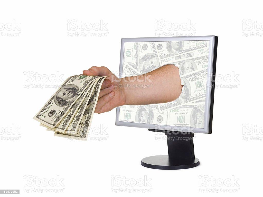 Mano con dinero Y monitor DE COMPUTADORA foto de stock libre de derechos