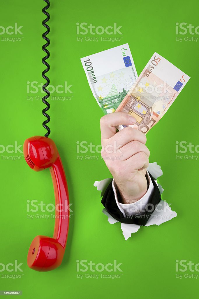 Hand with money and phone royalty-free stock photo