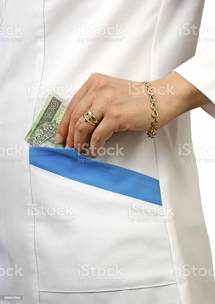 Hand with money in a pocket royalty-free stock photo