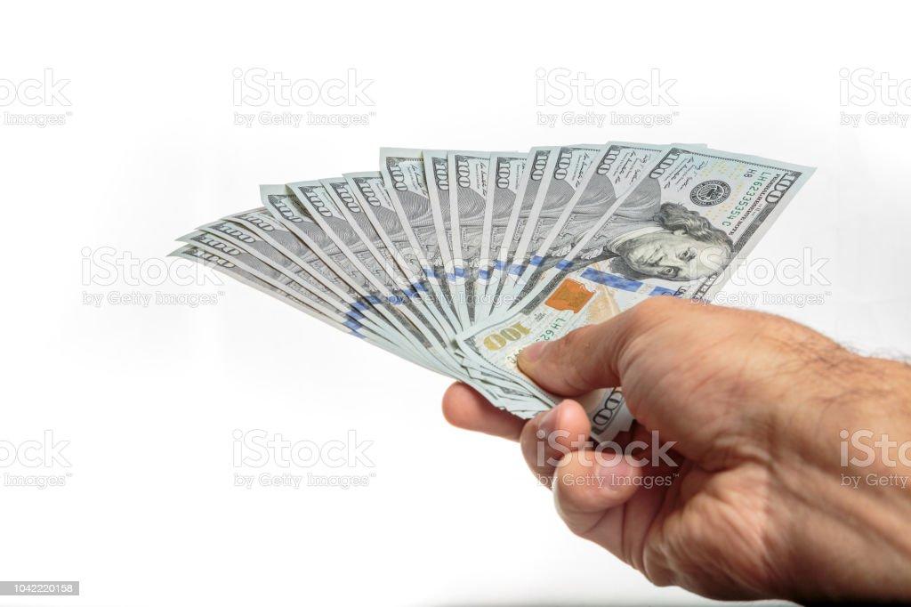Mano con dinero aislado sobre un fondo blanco  - foto de stock