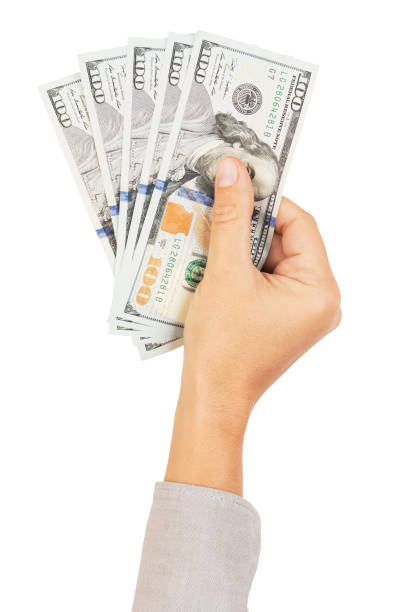 Hand with one hundred dollars banknotes, a concept of winner or successful business