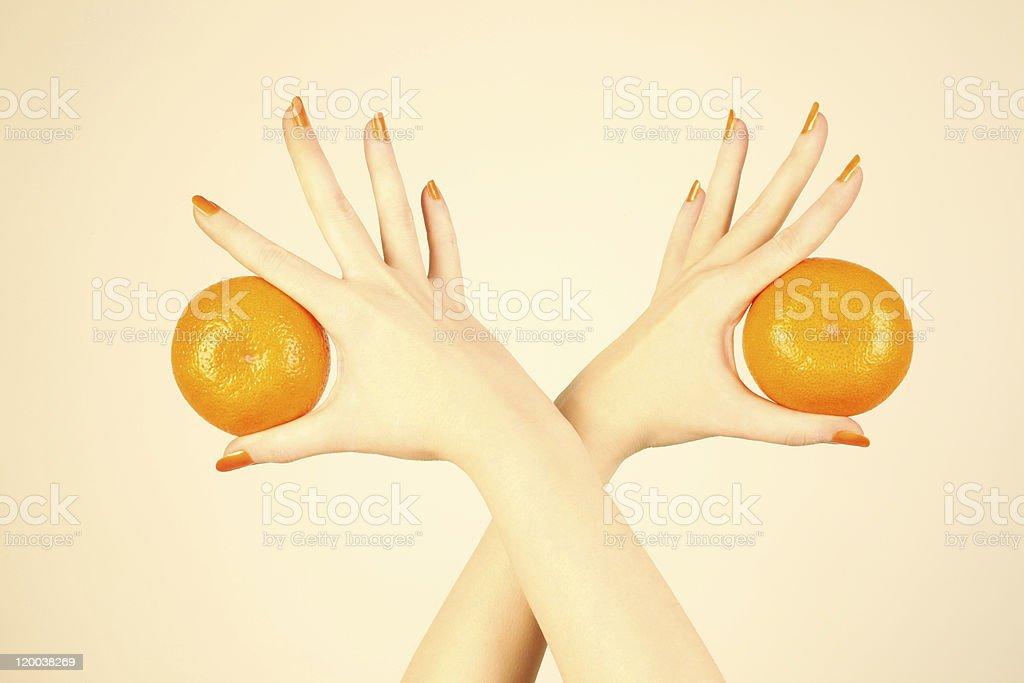 Hand with orange tangerine. royalty-free stock photo