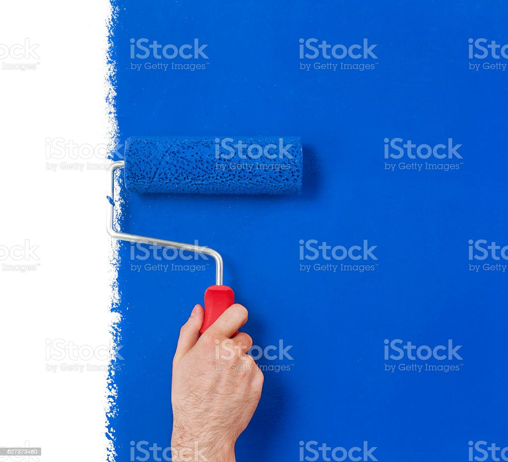 Hand with paint roller stock photo