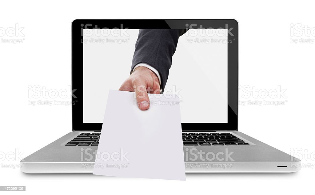 Hand with paper out of laptop stock photo