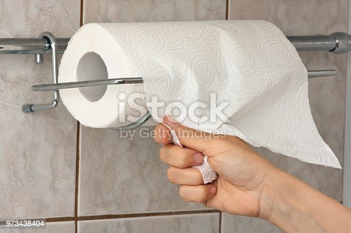 hand of woman with paper towel, closeup
