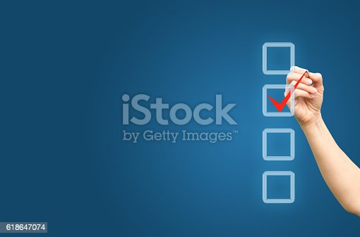 istock Hand with pen and check boxes 618647074