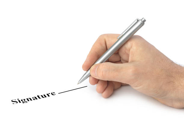 Hand with pen and contract stock photo
