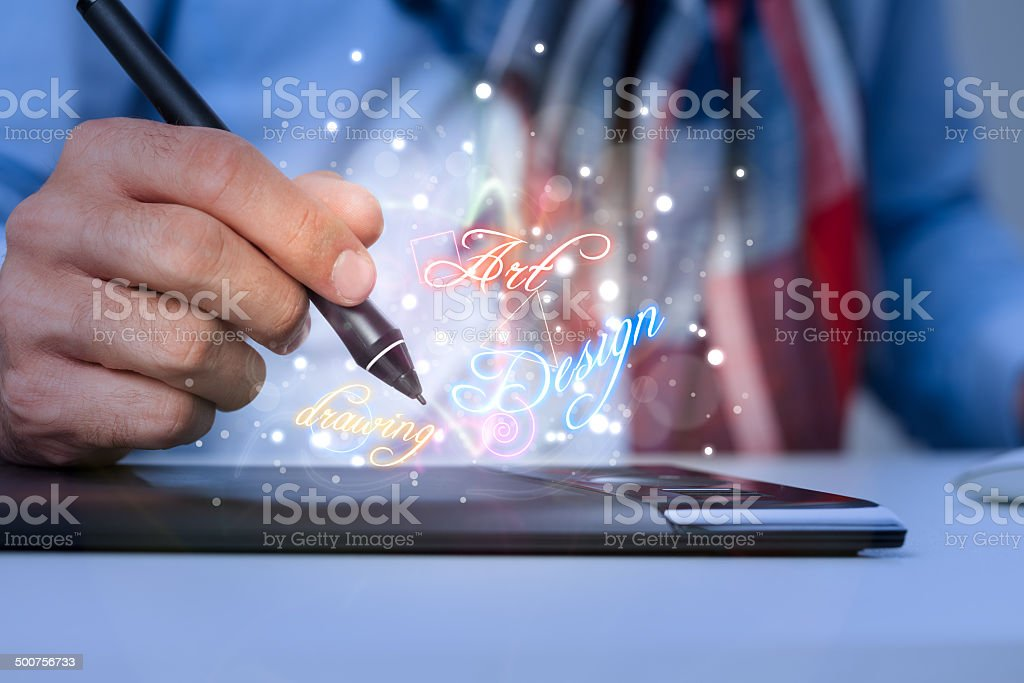 Hand with pen  and graphics tablet stock photo