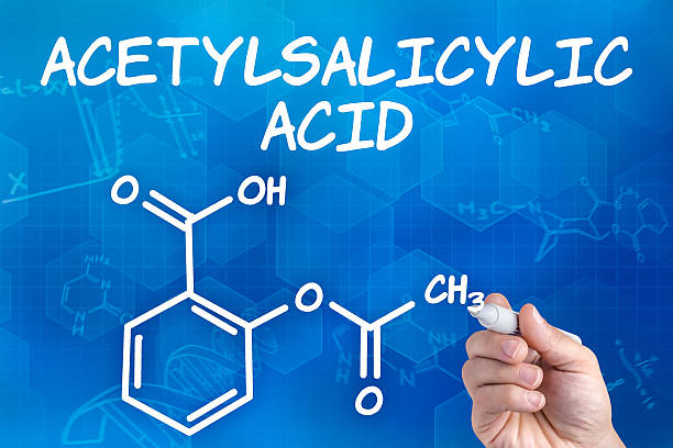 hand with pen drawing the chemical formula of acetylsalicylic acid hand with pen drawing the chemical formula of acetylsalicylic acid acetylsalicylic stock pictures, royalty-free photos & images