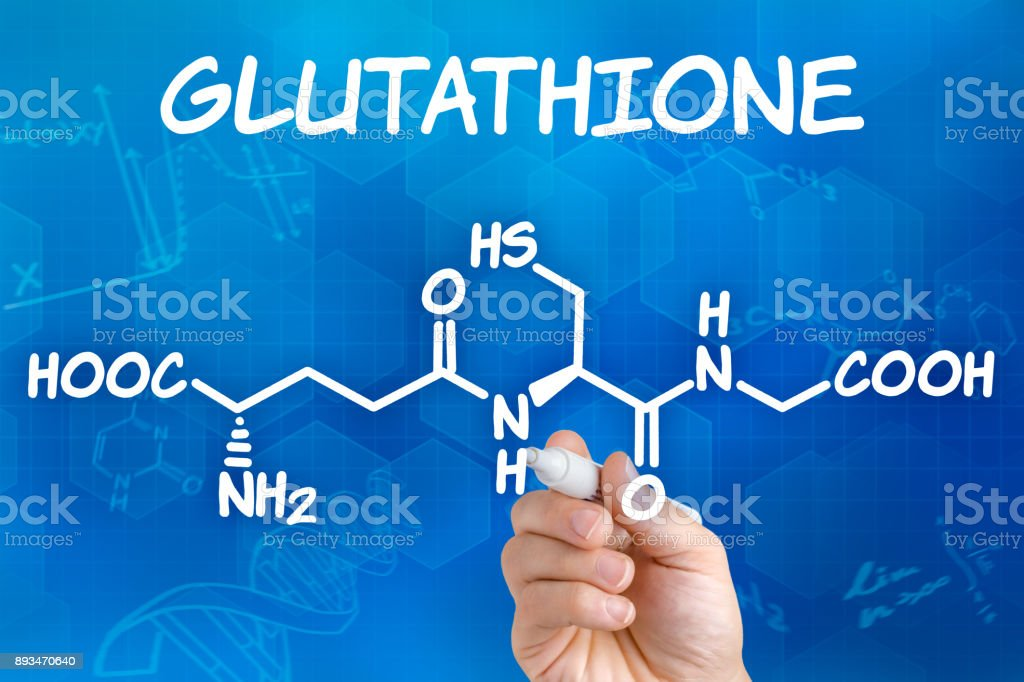 Hand with pen drawing the chemical formula of Glutathione stock photo