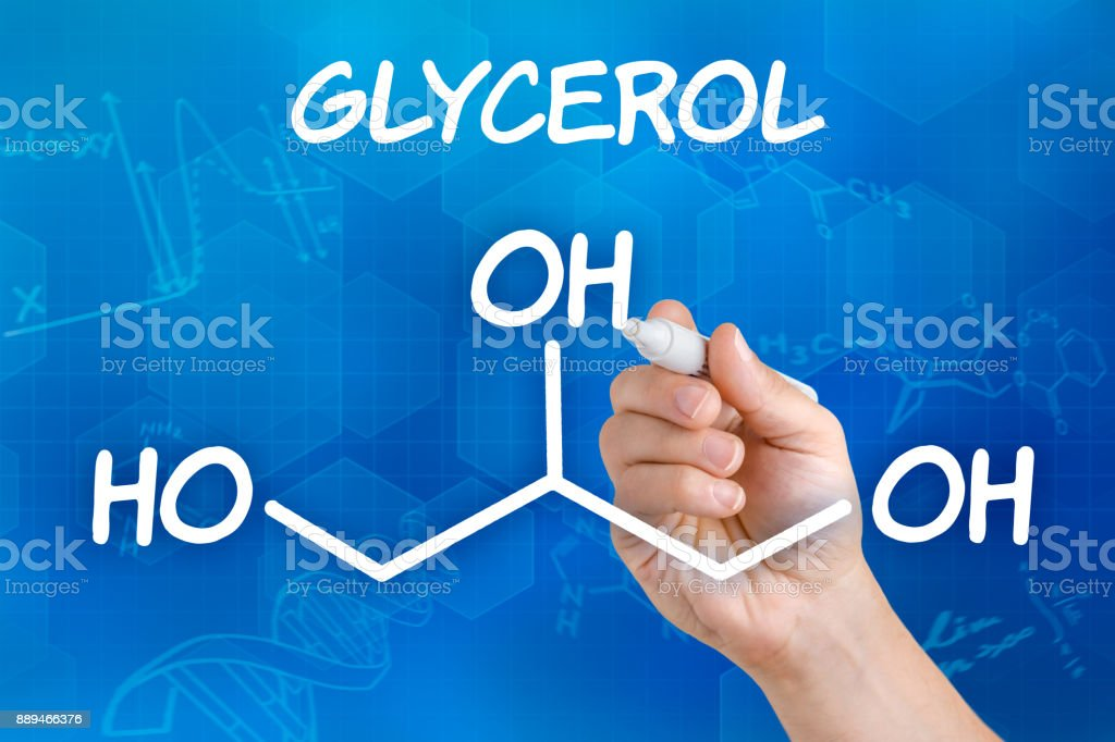 Hand with pen drawing the chemical formula of Glycerol stock photo
