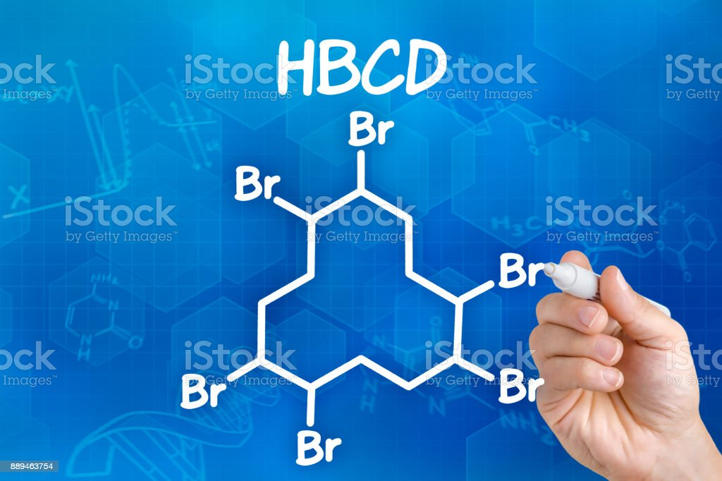 Hand with pen drawing the chemical formula of HBCD stock photo
