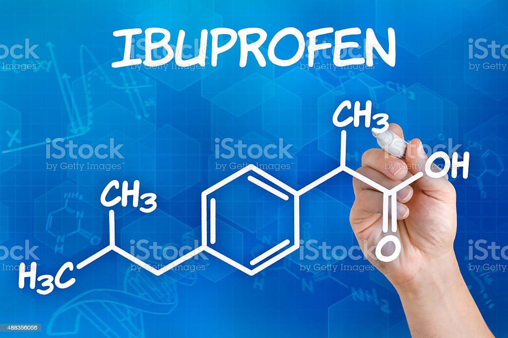 Hand with pen drawing the chemical formula of ibuprofen stock photo