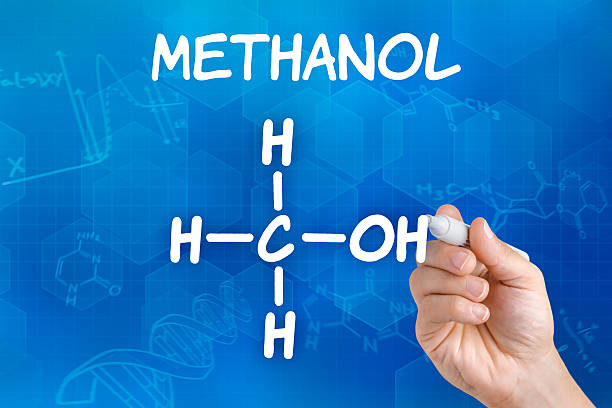 Hand with pen drawing the chemical formula of Methanol stock photo