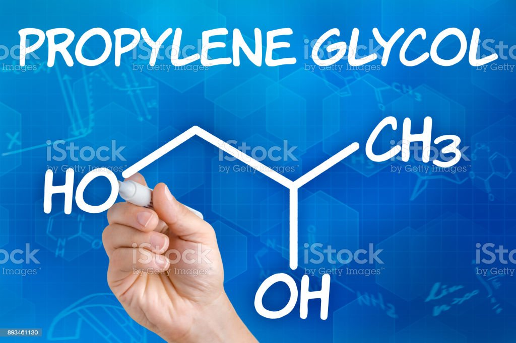 Hand with pen drawing the chemical formula of Propylene glycol stock photo