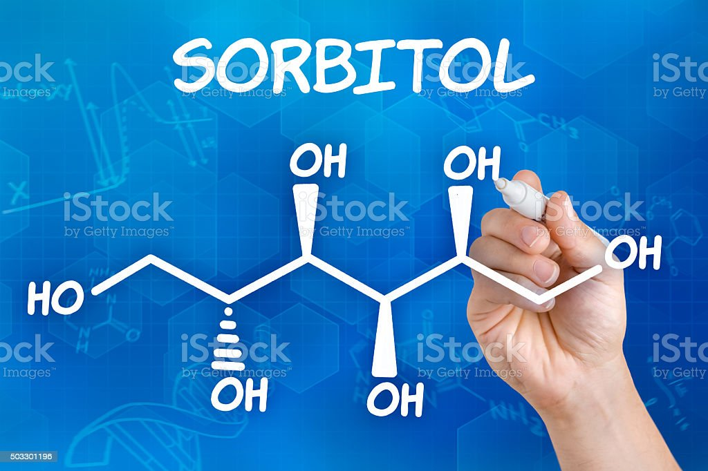 Hand with pen drawing the chemical formula of sorbitol stock photo