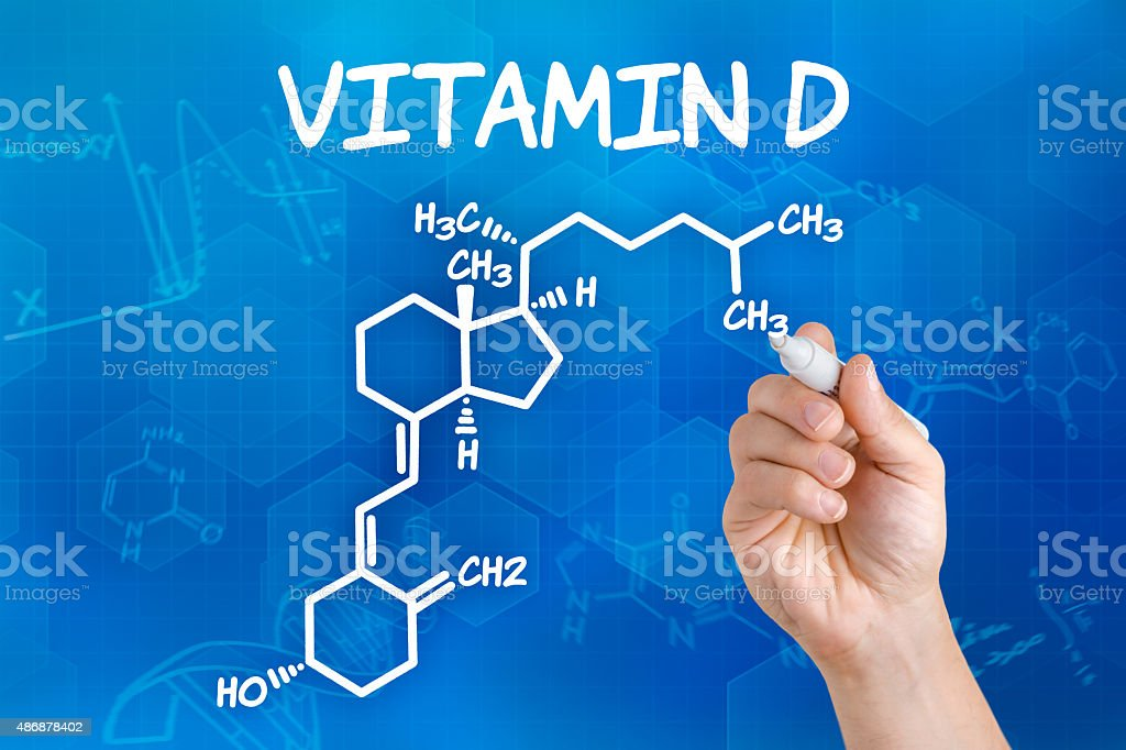 Hand with pen drawing the chemical formula of vitamin d stock photo