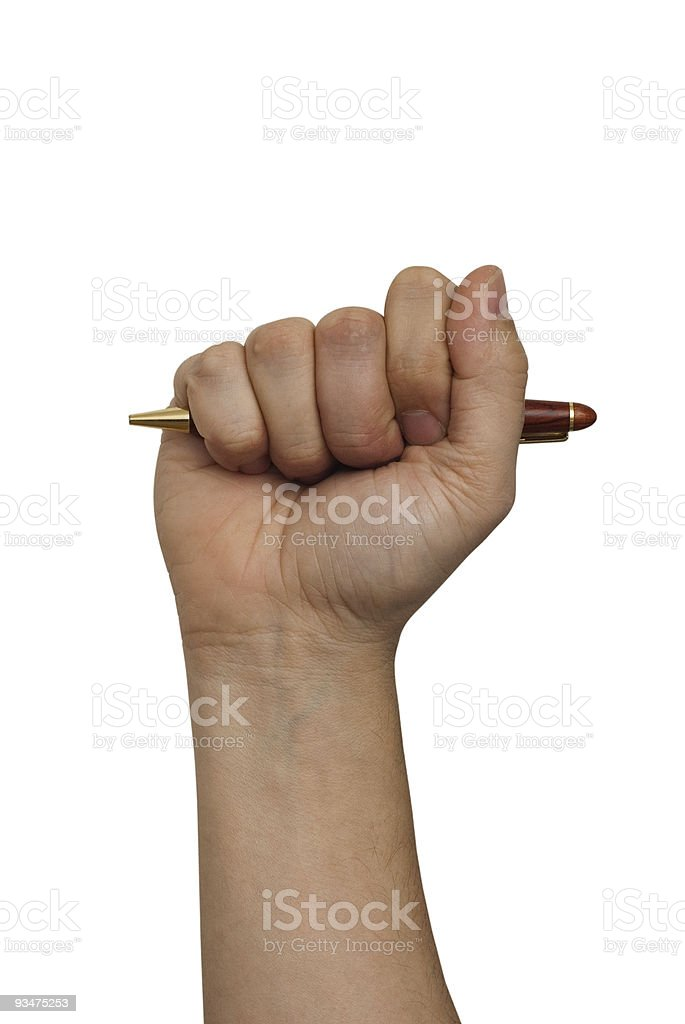 hand with pen in fist royalty-free stock photo