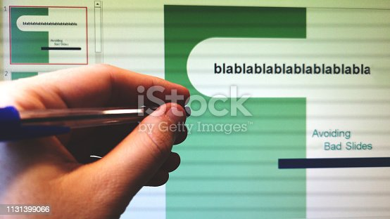 hand with pen indicates the screen with slides presentation program slideshow .