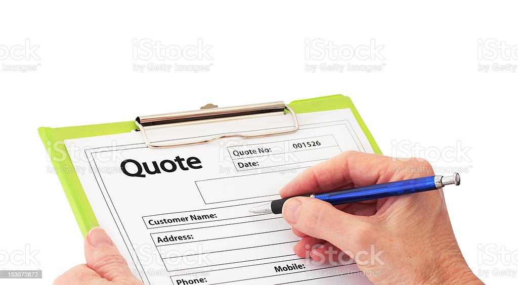 Hand with Pen Writing a Quote stock photo