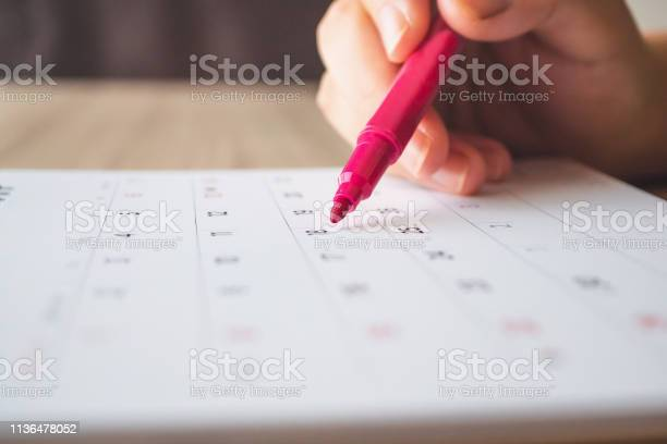 Hand with pen writing on calendar page closeup picture id1136478052?b=1&k=6&m=1136478052&s=612x612&h= uezxpwpemgeub7woyb gqk16ygx1kz9b jkkfubi1m=