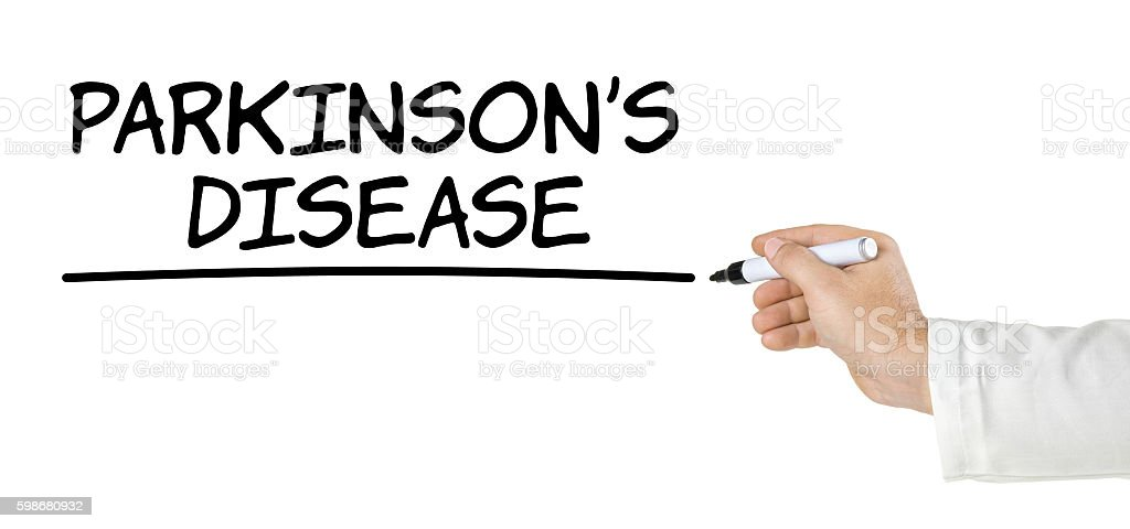 Hand with pen writing Parkinsons Disease stock photo