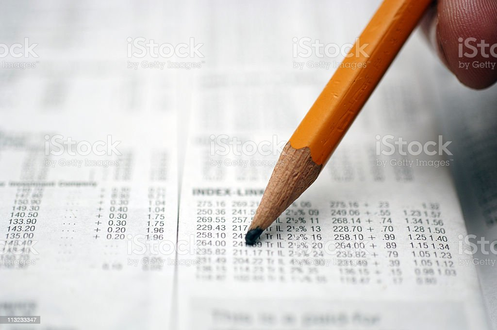 hand with pencil searching market prices royalty-free stock photo